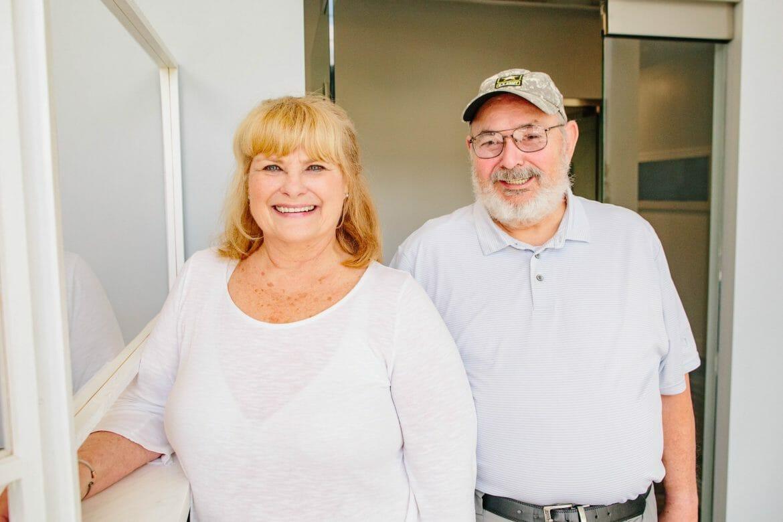 Older couple smiling at dental office